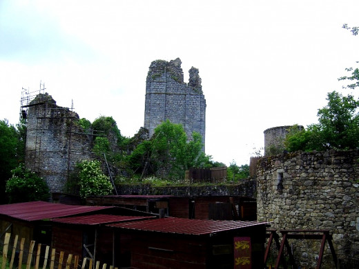 The ruined towers of Lastours castle looms above the trees