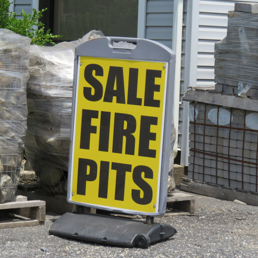 This moving Fire-Pits-for-Sale sign drew me in.