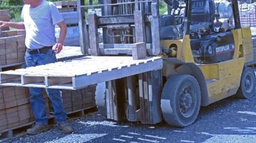 Bill, the yard guy, had just unloaded cultured stone from the forklift truck.