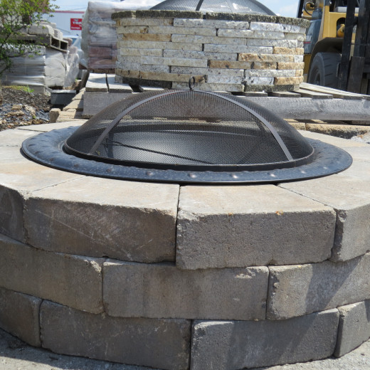 Side view: Fire pit enclosure, fire bowl, and spark screen.