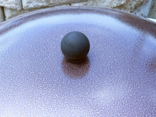 Closeup: Top knob of fire pit cover.