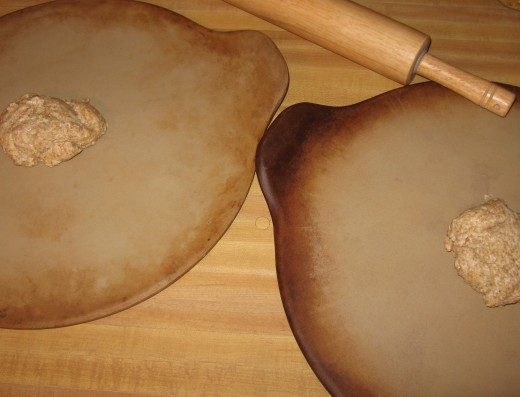 Roll dough onto two cookie sheets or pizza pans (we prefer pizza stones).  This is the most important part: Roll the dough VERY thin...as thin as you can roll it!  This makes the crackers crunchy.