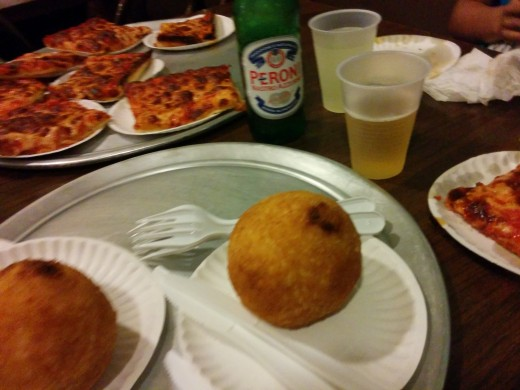 At Galleria Umberto in Boston's North End, $30 buys 10 slices (half a pan) of Sicilian-style pizza, 2 arancini, 1 Coke, 1 Minute Maid Lemonade, and 1 imported (Peroni, from Italy) beer.