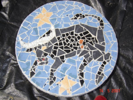 "outside septic tank cover (mosaic cemented to 36"" 60 pound cement slab"