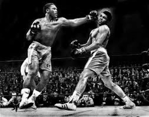Joe Frazier lands a booming right hand that floored Muhammad Ali in the 15th round to secure a decision victory.