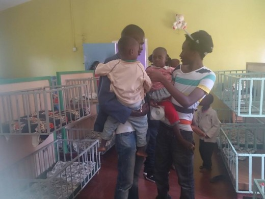 My African sons loving on orphans