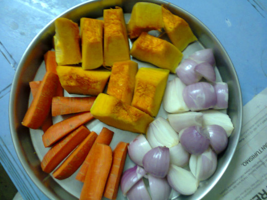cut pieces of pumpkin, carrot and onions