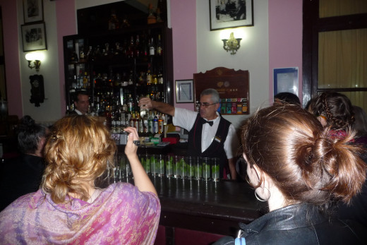 The bartender rustling up some Mohitos in the Cigar Bar