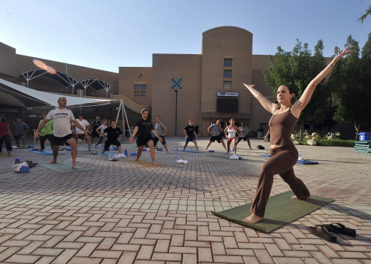 Get Fit and Healthy (Image- Outdoor Yoga Class)