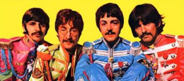 George Harrison and the rest of the Beatles posing for the Sargent Pepper album cover, photo from album via wikipedia