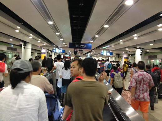 Everyday thousands of commuters go to mainland China via Lowu port.
