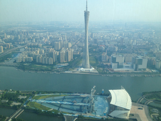 Guangzhou TV tower as seen from 70th floor coffee shop of the Four Seasons Hotel.  Tower is lit up with colorful lights every day between 7 to 8 pm