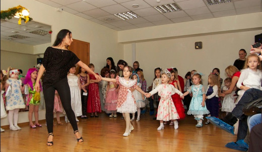 Young girls in a dance class learning social skills, including how to cooperate and get along.