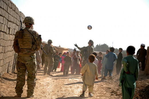 Soldier and Afghan children play nicely