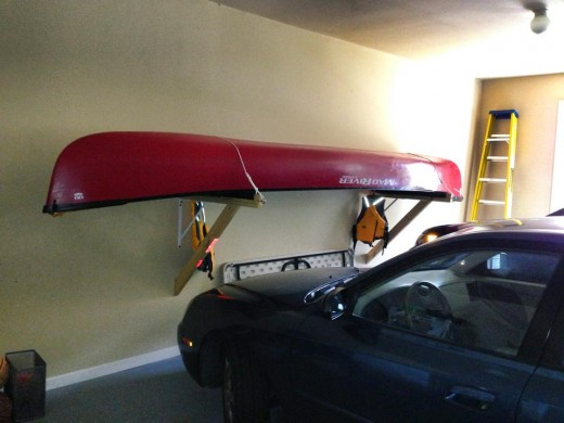 The completed Canoe shelf gives you more room to park your car in the garage while making it easier to load onto the rack and remove.