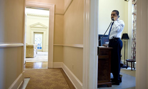 Barack Obama on phone in the West Wing private study. Calling governors hit by economic crisis