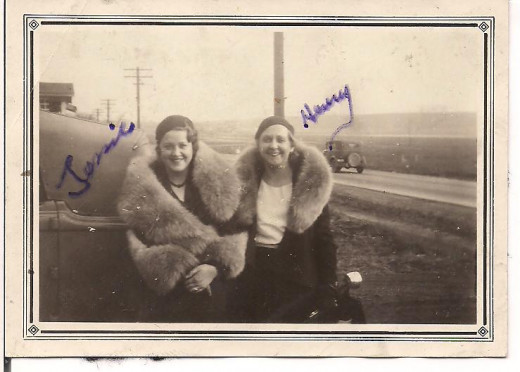Jessie and her fellow pilot and close friend, Henrietta Faux, pose in fancy furs and dresses aside from their regular pilot suits (1930s)