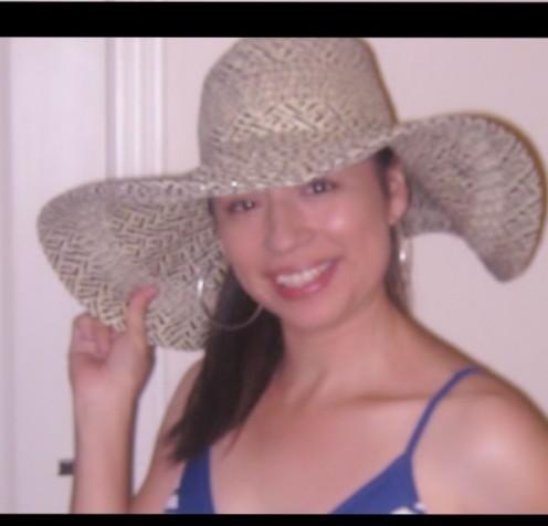 Sandra Q. Sporting The Timeless Floppy Hat