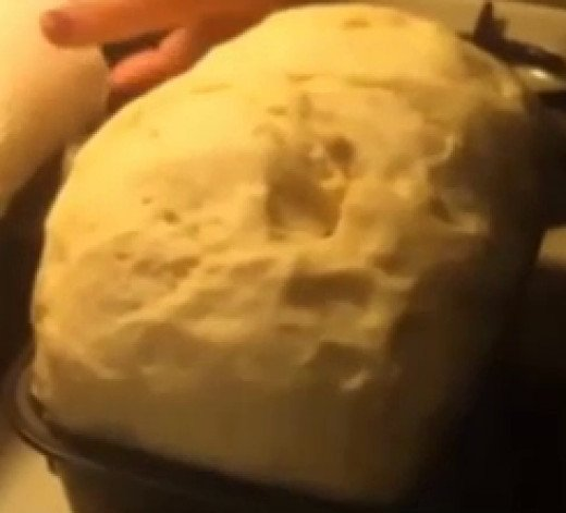 After the dough has risen in the bread pans they are ready to be put into the oven