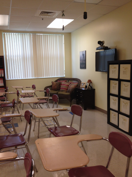Placing a small couch, a couple of throw pillows, and a small table in a corner creates a positive learning space for individuals or small groups.