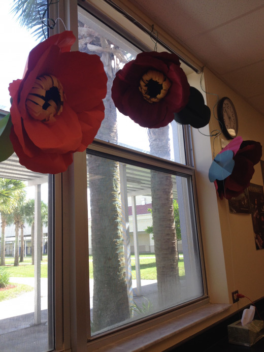 Choose a theme that will help students connect with the learning.  Here a string of huge paper flowers enhanced the study of plant life.