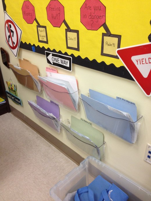 Bins hung on a wall function well for holding important forms, paperwork that is due,  or as extra credit work.