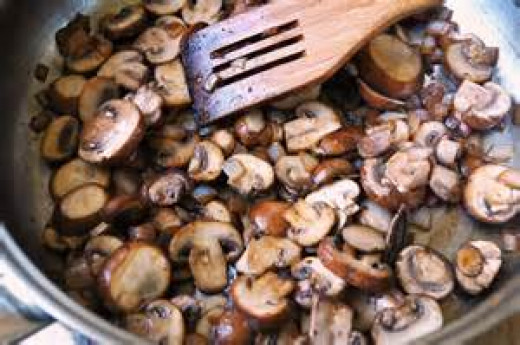 Browning mushrooms and garlic