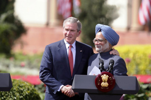 President George W. Bush and India's Prime Minister Manmohan Singh exchange handshakes Thursday, March 2, 2006, after their press availability at the Hyderabad House in New Delhi.