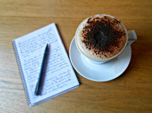 A cappuccino, and author's notes, showcases a relaxing atmosphere.