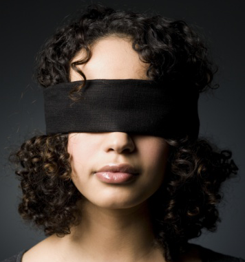 A woman in blindfold