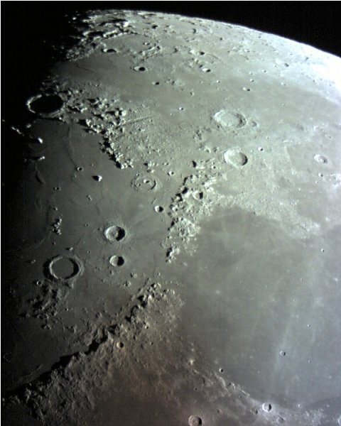 The smooth dark areas on the moon are called maria. This is lava that has flowed out from the moon over its surface.
