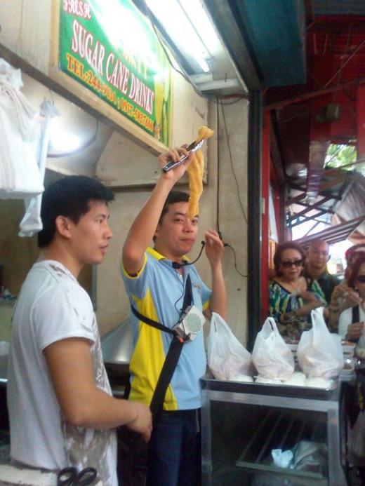 Ivan holding up the bicho-bicho.