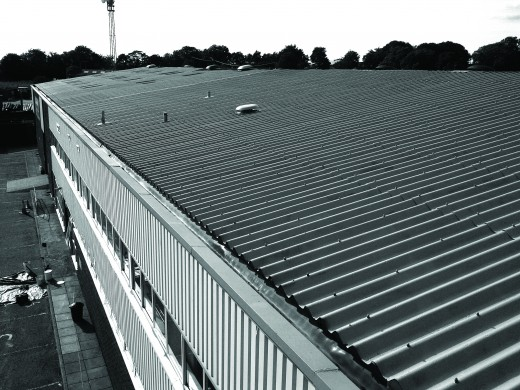 A corrugated asbestos roof that has been encapsulated in a rubber coating