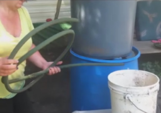 The only tools you need to siphon rainwater is an empty container and a good rubber hose.