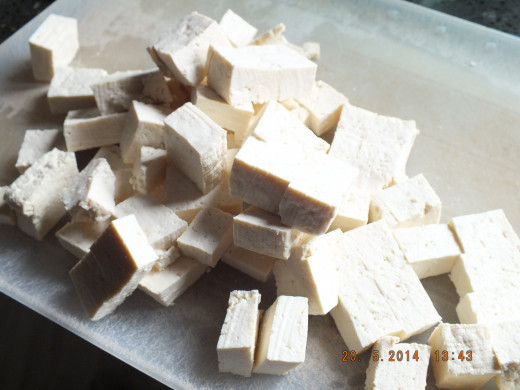 The tofu has finished draining and I have sliced it into cubes.