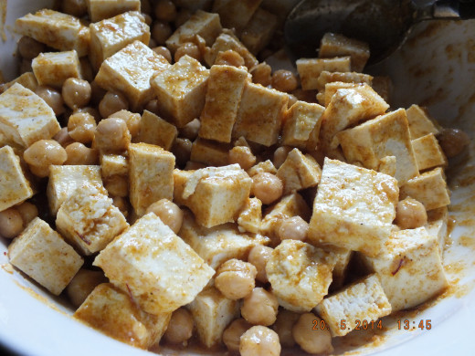 Give it a good stir. You want to be gentle as not to break up the tofu, but thorough as to cover everything in sauce.