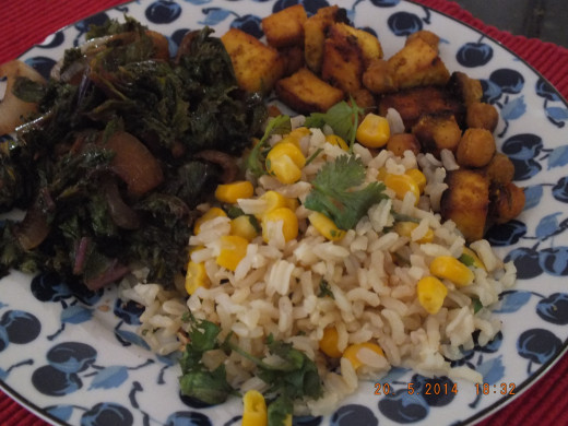 I served the chickpeas and tofu with my swiss chard and onions recipe along with a side of brown rice and corn.