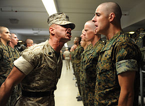A USMC Drill Instructor had at work with a new recruit.