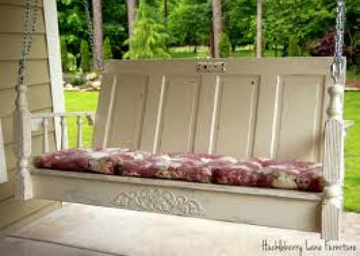 This old six panel door was converted into a one of a kind porch swing