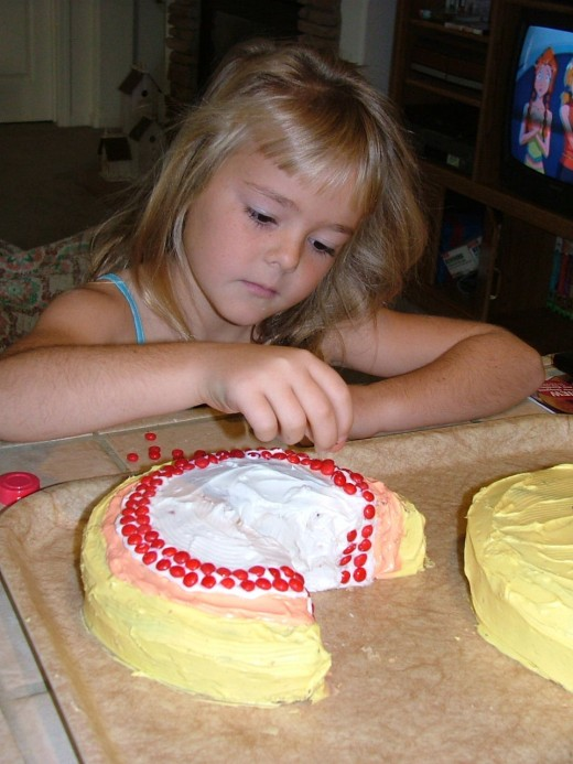 Employ your child to help decorate the cake.