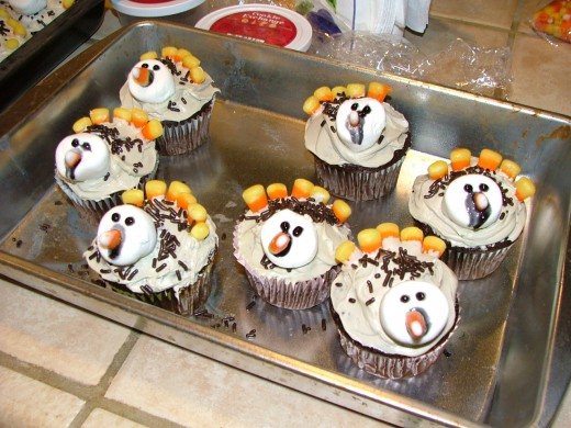 """Have a cupcake Decorating contest.  Model it after """"American Idol"""" with adult judges and certificates for the winners of the """"scariest"""", """"funniest"""" and """"most creative.""""  Supply the bakers with iced cupcakes and bowlful of different candies to create."""