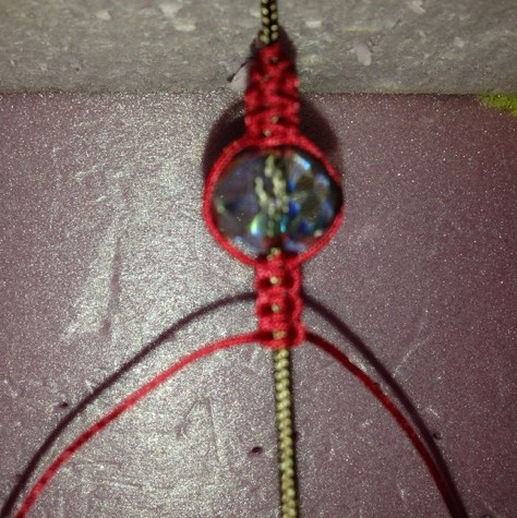 Tie 3 square knots, then add a bead.