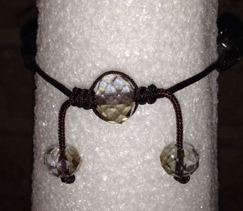 The beaded closure of the bracelet