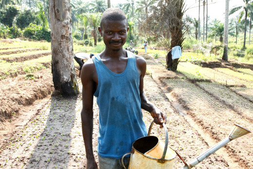 Gedeon Kalenga, a member of a community nutrition group in Masi Manimba. The community works together on a voluntary basis to grow food for 35 families, but they only have two watering cans to irrigate the fields - meaning back-breaking work going up