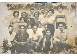 Isabel's father in the black shirt kneeling with his family