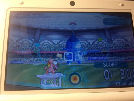 The mini-game involves your Pokémon shooting soccer balls at a Pokemon balloon,