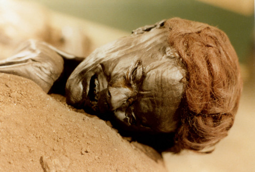 The face of the bog body known as Grauballe man, discovered in 1952 in Denmark.