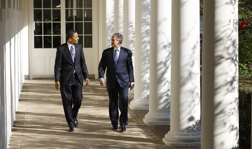 President George W. Bush and President-elect Barack Obama walk the Colonnade to the Oval Office Monday, Nov. 10, 2008, as the President and Mrs. Laura Bush welcomed the President-elect and his wife, Michelle, to the White House.