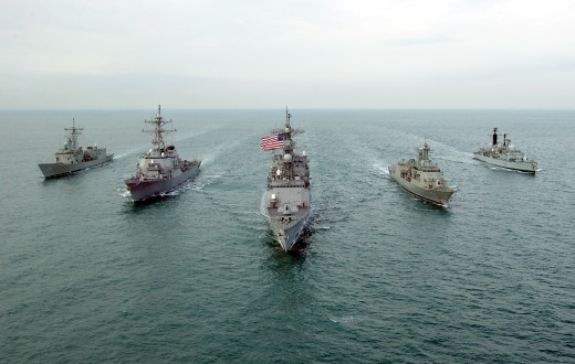 Warships of the US, the UK and Australia moving together