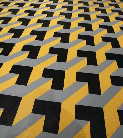 A photo that shows flat tiles on a floor. If you want to see them as flat tiles you will see them as such. If you want to see them as rising stairs, it's all up to you.